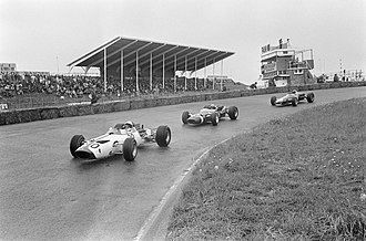 McLaren M2B - McLaren, driving a Serenissima-engined M2B, leads a train of three cars during practice for the 1966 Dutch Grand Prix