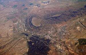 Grants, New Mexico - Aerial view of Grants in 2007. Black Mesa is above town, and to the west Grants adjoins Milan. Interstate 40 bends to avoid the mesa.