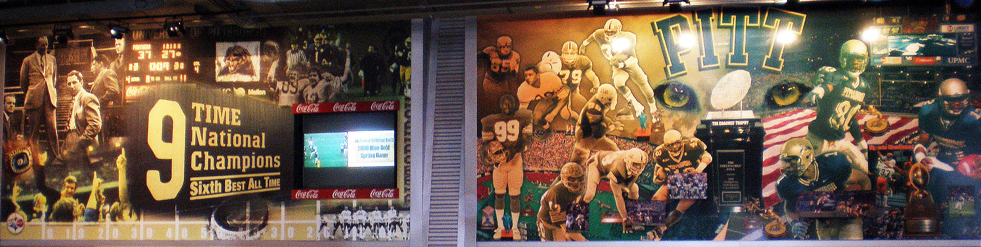 Pitt football murals displayed in the Great Hall of Heinz Field GreatHallPittmuralsCrop.jpg