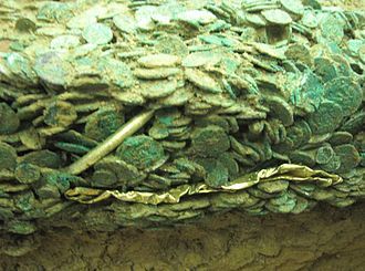 Grouville Hoard - Two gold torcs have been identified at the edge of the mass of coins.