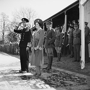 Charles Walter Allfrey - HM King George VI and Queen Elizabeth on a visit to Southern Command, 6 May 1942. At the saluting base, the King salutes as the troops march past. Standing behind them is Lieutenant General Charles Allfrey.