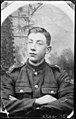 Half-length portrait of a young man in military uniform with his arms crossed (10941358665).jpg
