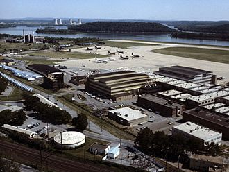 Three Mile Island in background behind Harrisburg International Airport, a few weeks after the accident. Harrisburg Int Airport with Pennsylvania ANG aircraft 1979.jpg