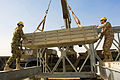 Hauling elements of a Maybey bridge in Camp Gazi, Afghanistan.jpg