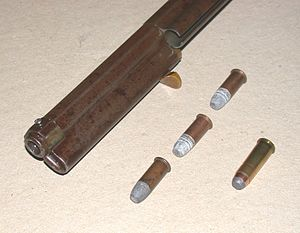 Magazine (firearms) - Loading sleeve open, three Henry Flat cartridges, compare with .44 WCF round
