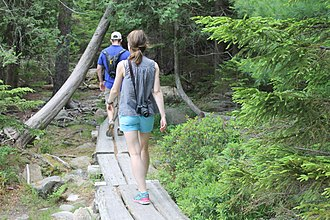 Jordan Pond - Hikers on the trail which encircles Jordan Pond.
