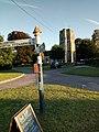 Hillfarrance church with village signpost.jpg