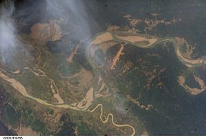 Satellite view. The long strip is Homalin Airport. The meandering Uyu river can be seen joining the Chindwin river south of the town.