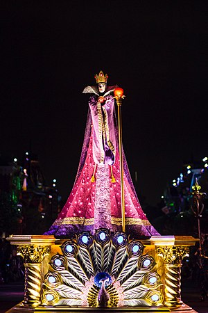 Evil Queen (Disney) - The Evil Queen scowling by the light of an apple during Hong Kong Disneyland's Villains Night Out! parade, premiering in 2016, with the peacock motif also prominent