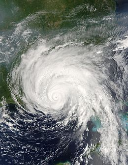 A view of Hurricane Dennis from Space on July 10, 2005. The storm's small eye is visible at the center of the image. Dennis is located south of Pensacola, Florida, in the Gulf of Mexico. The western tip of Cuba is seen on the right side of the image.