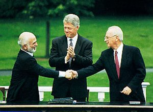 Israel–Jordan peace treaty - A handshake between King Hussein and PM Rabin, accompanied by President Clinton, during the Israel-Jordan peace negotiations, July 25th, 1994