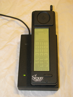 English: IBM Simon smartphone in charging station.