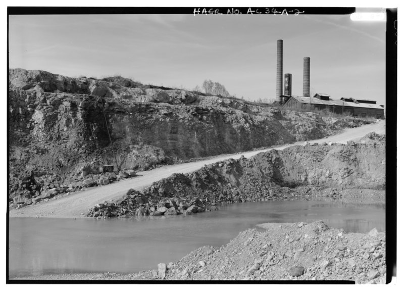 File:INTERIOR VIEW, NORTH QUARRY, AN ACTIVE DOLOMITE QUARRY, LOOKING NORTH TO THE POWER PLANT OF THE HISTORIC THOMAS COKEWORKS SITE. - Wade Sand and Gravel Company, North Quarry, HAER ALA,37-THOS,8A-2.tif