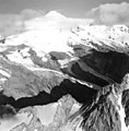 Iliamna Volcano, source of valley glaciers with icefall, and bergschrund faintly visible on the upper portions, September 3, 1966 (GLACIERS 6588).jpg
