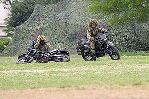 Reconnaissance - A two-man JGSDF team mans Kawasaki KLX250 dirt bikes in the reconnaissance role during a public demonstration