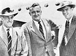 Jack Iverson flanked by Ian Johnson (cricketer) and Bill Johnston (cricketer) in January 1951.jpg