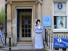 Photograph of a building decorated with Jane Austen posters and paraphernalia, including a mannequin dressed in early 19th-century clothing.