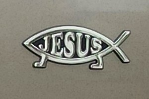 Ichthys - Jesus Fish on a car, promoting evolutionary creation. Other Jesus fish emblems oppose or promote evolution, or feature Cthulhu to parody religious belief.
