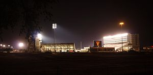 Jones AT&T Stadium - View (looking south) at night in August 2010 with construction of the east side ongoing