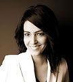 Kavita Oberoi publicity photo - close-up in sepia.jpg