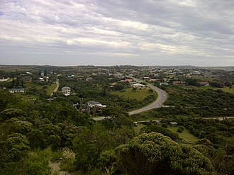 Kei Mouth - A view of Kei Mouth from the hill, showing the tarred road into the village