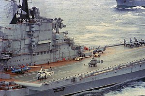 Soviet aircraft carrier Kiev - '''Ka-27 Helix''' and '''Ka-25 Hormone''' helicopters and '''Yak-38 Forger VTOL''' aircraft are parked on the flight deck. 6 Jan 1988