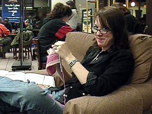 Hand knitting - This woman is knitting at a coffee shop; although it can be done by one person alone, knitting can be a social activity. There are many knitting guilds and other knitting groups or knitting clubs.