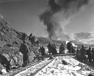 7th Marine Regiment (United States) - Marines watch F4U Corsairs drop napalm as Item Company, 7th Marine Regiment move in to attack Chinese positions.