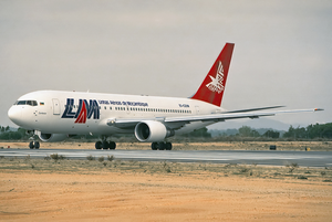 LAM Mozambique Airlines - An Ireland-registered Boeing 767-200ER wearing a LAM Mozambique Airlines livery at Faro Airport in 1993.