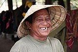 Laotian laughing man with hat.jpg