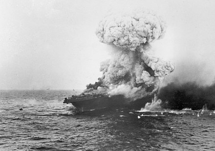 The aircraft carrier USS Lexington explodes on 8 May 1942, several hours after being damaged by a Japanese carrier air attack. Large explosion aboard USS Lexington (CV-2), 8 may 1942.jpg