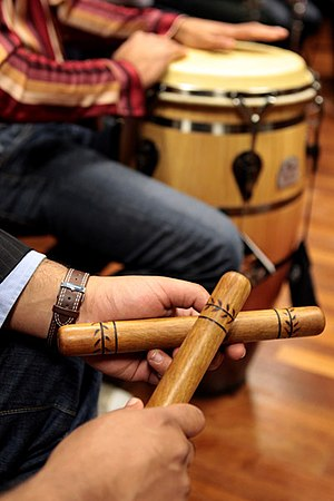 Percussion instrument - Concussion idiophones (claves), and struck drums (conga drum)