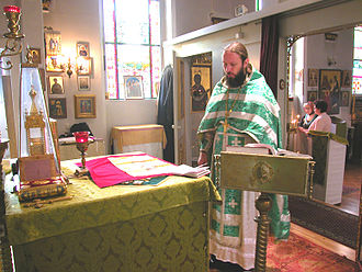 Antependium - Russian Orthodox priest standing in front of a fully vested altar (Düsseldorf, Germany).