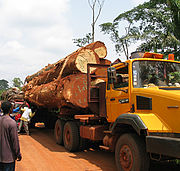 A bush taxi attempts to pass a stalled logging vehicle on the road between Abong-Mbang and Lomié, East Province.