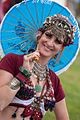 Lovely belly dancer with a blue parasol (8104156802).jpg