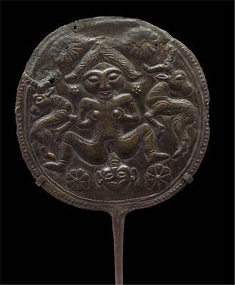 Brooch - Disk pin with woman giving birth, flanked by antelopes from Luristan bronze.