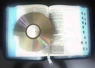 Gospel music - Exemplification of gospel music: an open Bible and a CD, which represent the gospel in written and musical forms