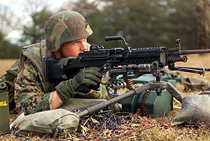 M249 light machine gun - A U.S. Marine firing an M249 from an M122A1 tripod at a training range in November 2003.