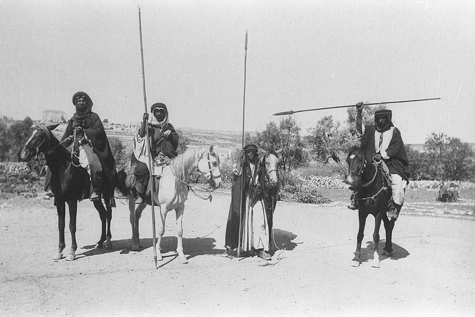 MOUNTED BEDUIN FIGHTERS ARMED WITH SPEARS POSE IN A PHOTO TAKEN IN THE JERUSALEM AREA DURING THE OTTOMAN ERA IN ERETZ YISRAEL. צילום לוחמים בדואים חמושים בחניתות על סוסיהם, בצ