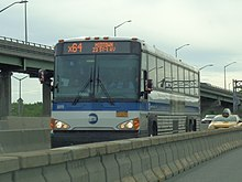 The combined bus and high-occupancy-vehicle lane on the Long Island Expressway, near the interchange with the Brooklyn–Queens Expressway