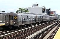 MTA NYC Subway N train arriving at 36th Ave.jpg