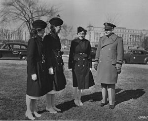 Quartermaster General of the United States Army - Quartermaster General Maj Gen Gregory discusses Army nurses' clothing with Lt. Alice Montgomery, Lt. Josephine Etz, and Lt. Leophile Bouchard, of Walter Reed Hospital. The Quartermaster General is responsible for supplying all branches of the Army.