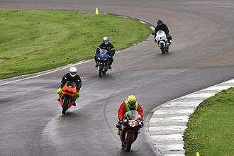 Mallory Park - Motorcycle riders passing through the John Cooper Esses, taking part in a circuit track day