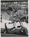 Man nailing a bundle of shingles, ca 1915 (MOHAI 6320).jpg