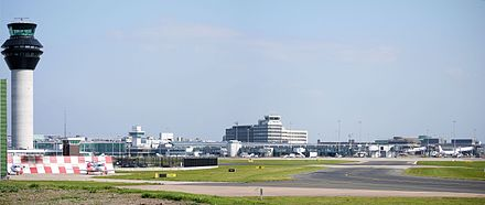 Manchester Airport viewed from the south-west Manchester Airport Panorama September 2014.jpg
