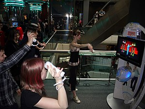 Gamer - Video gamers play Wii's fitness game.