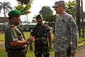 Marciano Norman speaking with US Sgt Major.jpg