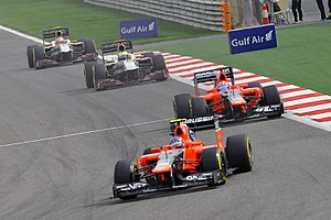 Marussia F1 - The Marussias of Charles Pic and Timo Glock leading the HRT's of Pedro de la Rosa and Narain Karthikeyan during the 2012 Bahrain Grand Prix