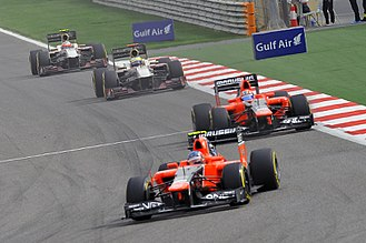 Marussia F1 - The Marussias of Charles Pic and Timo Glock leading the HRTs of Pedro de la Rosa and Narain Karthikeyan during the 2012 Bahrain Grand Prix