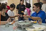 Members of the 353rd Special Operations Group help children in the Phillipines 170221-N-IM663-123.jpg